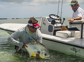 Flats fishing in Key West for permit. Capt. Steven Lamp holds up a nice permit.